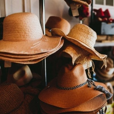 Straw beach hats at Frolic in New Buffalo, Michigan.