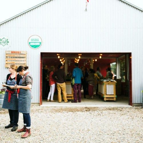 Gathering before dinner in the market at Granor Farm in Three Oaks, Michigan.