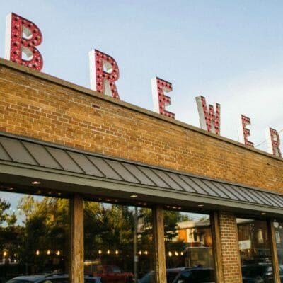 Greenbush Brewing's brick exterior with large windows and letters that spell 'brewery' on the roof.