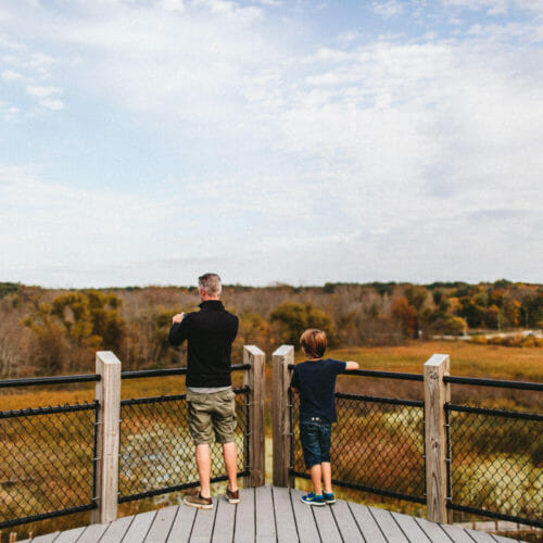 Father and son at the overlook at Galien River County Park in New Buffalo, Michigan.
